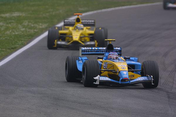 2003 San Marino Grand Prix - Sunday Race,Imola, Italy.20th April 2003.Jarno Trulli, Renault R23, leads Giancarlo Fisichella, Jordan Ford EJ13, action.World Copyright LAT Photographic.ref: Digital Image Only.