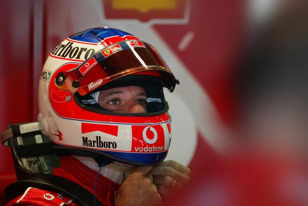 2004 German Grand Prix - Friday Practice,Hockenheim, Germany. 23rd July 2004 Rubens Barrichello, Ferrari F2004, puts on his crash helmet.World Copyright: Steve Etherington/LAT Photographic ref: Digital Image Only