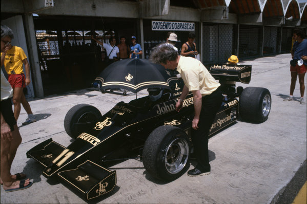 Jacarepagua, Rio de Janeiro, Brazil.Elio de Angelis (Lotus 91 Ford), in the pits, action. World Copyright: LAT Photographic.Ref:  83F1
