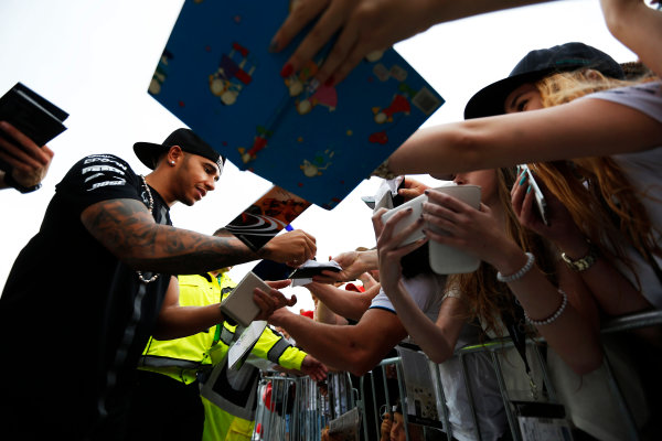 Hungaroring, Budapest, Hungary. Thursday 23 July 2015. Lewis Hamilton, Mercedes AMG, signs autographs for fans. World Copyright: Charles Coates/LAT Photographic ref: Digital Image _N7T1843