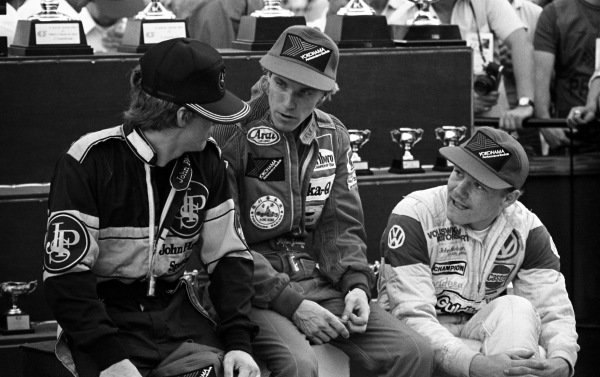 (L to R): Mike Thackwell (NZL) Team JPS (3rd); Stefan Johansson (SWE) Marlboro Theodore Racing Team (2nd); and Macau Grand Prix winner John Nielsen (DEN) Volkswagen Motorsport, wait for the podium ceremony. XXXI Grande Premio de Macau, Circuito da Guia, Macau, 18 November 1984.