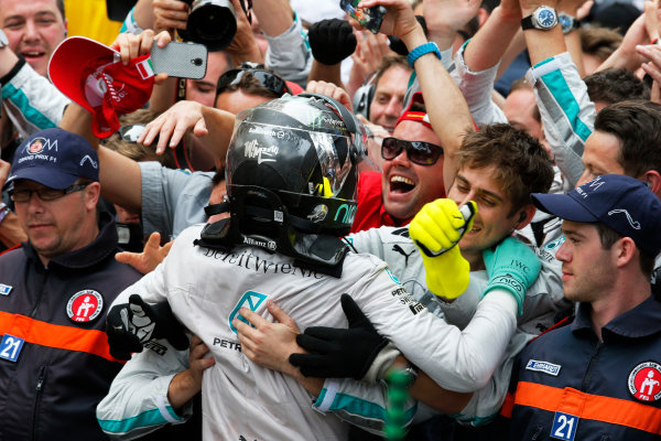 Monte Carlo, Monaco. Sunday 25 May 2014. Nico Rosberg, Mercedes AMG, 1st Position, celebrates in Parc Ferme, with his team. World Copyright: Steven Tee/LAT Photographic. ref: Digital Image _L4R7526