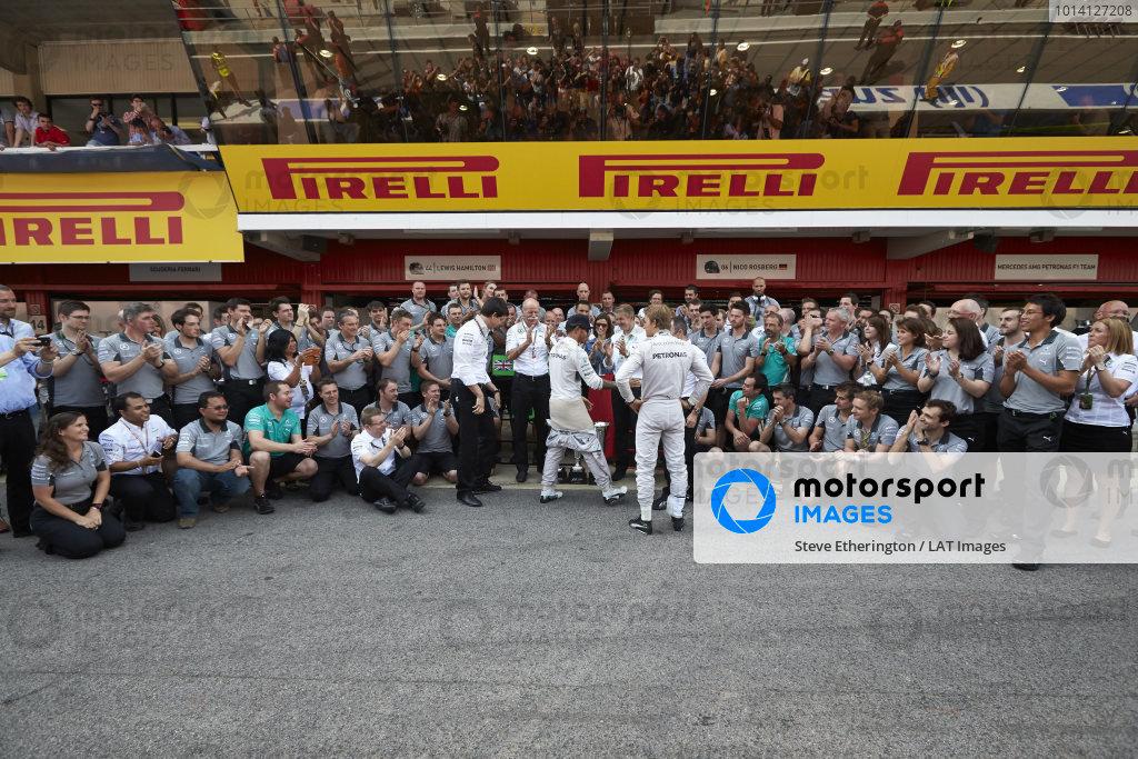 Circuit de Catalunya, Barcelona, Spain. Sunday 11 May 2014. Lewis Hamilton, Mercedes AMG, 1st Position, Nico Rosberg, Mercedes AMG, 2nd Position, and the Mercedes AMG team celebrate a perfect weekend. World Copyright: Steve EtheringtonLAT Photographic. ref: Digital Image SNE25413 copy