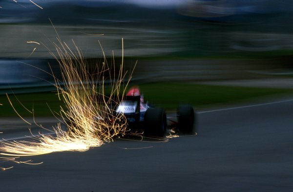The sparks fly from the back of the TyrrellÊ020C of Ukyo Katayama (JPN)Formula One Testing, Silverstone, England. 1993