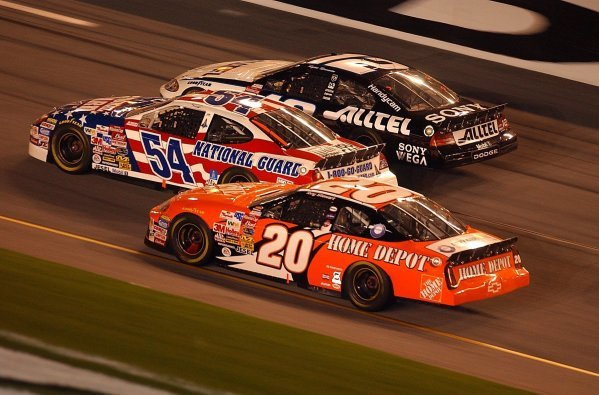 Three abreast as they approach the finish line (L to R): Fifteenth placed Tony Stewart (USA) Home Depot Pontiac; Todd Bodine (USA) Army National Guard Ford, who finished thirteenth; Ryan Newman (USA) ALLTEL Ford who finished fourth.