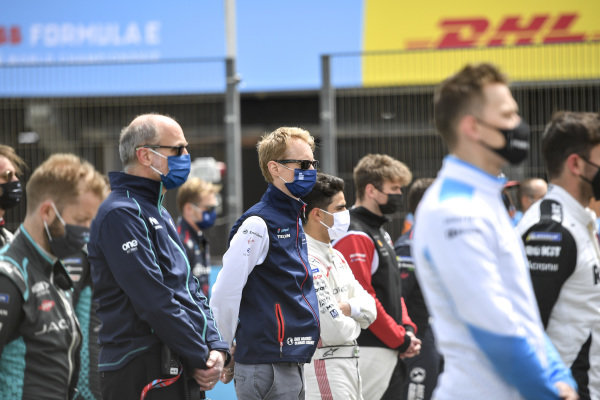 Christian Silk, Team Principal, NIO 333, Sylvain Filippi, Managing Director, Envision Virgin Racing, and the other drivers and team members stand in memory of the late Adrian Campos