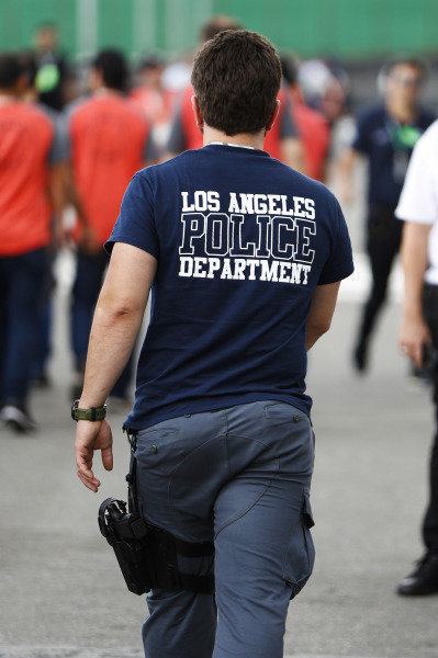A man in a Los Angeles Police T-shirt.