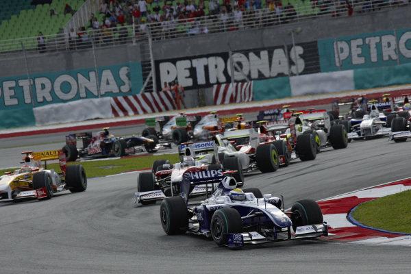 Nico Rosberg, Williams FW31 Toyota leads Jarno Trulli, Toyota TF109, Jenson Button, Brawn BGP 001 Mercedes and Kimi Räikkönen, Ferrari F60 with Fernando Alonso, Renault R29 out wide.