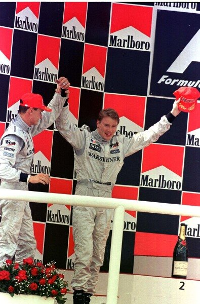 1998 Spanish Grand Prix.Catalunya, Barcelona, Spain.8-10 May 1998.Mika Hakkinen and David Coulthard (both McLaren Mercedes-Benz) after finishing in 1st and 2nd positions respectively.World Copyright - LAT Photographic