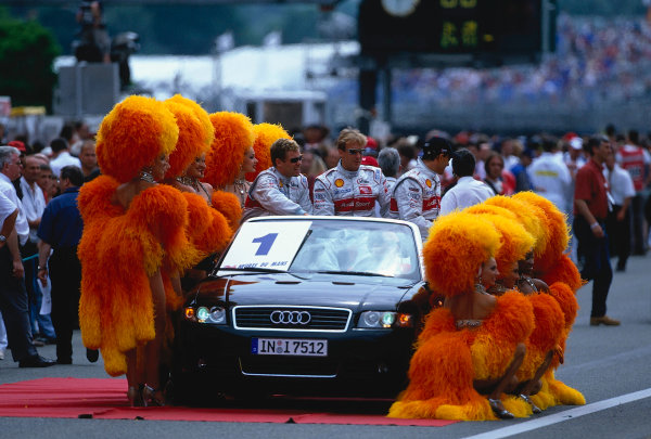 2002 Le Mans 24hr, La Sarthe, France, 15 -16 June 2002. Audi drivers Kristensen, Biela and pirro surrounded by the Glitz and Glamour of Le Mans. World Copyright: LAT Photographic Ref: 02LM33.