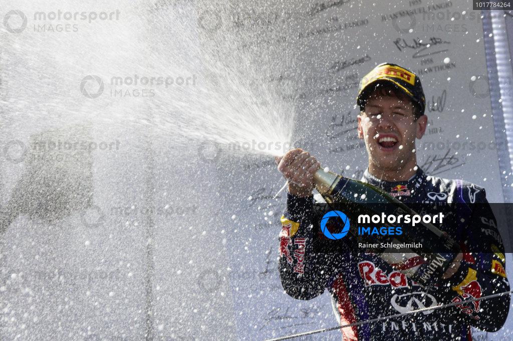 Sebastian Vettel, 1st position, celebrates on the podium.