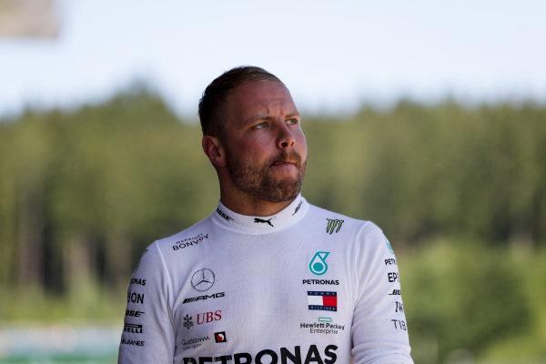 Valtteri Bottas, Mercedes AMG F1 walks down the pit lane after his crash