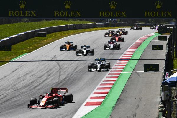 Charles Leclerc, Ferrari SF90, leads Valtteri Bottas, Mercedes AMG W10, Lewis Hamilton, Mercedes AMG F1 W10, Lando Norris, McLaren MCL34, Kimi Raikkonen, Alfa Romeo Racing C38, Sebastian Vettel, Ferrari SF90, and the rest of the field at the start