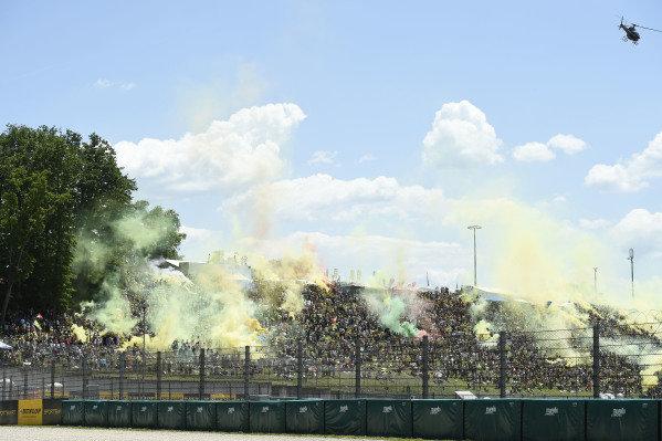 Crowds, flares.