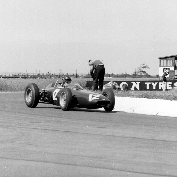 1962 British Grand Prix.Aintree, England.19-21 July 1962.Graham Hill (BRM P57) 4th position.Ref-14844.World Copyright - LAT Photographic
