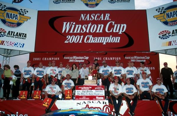 Jeff Gordon (USA) celebrates his fourth Winston Cup title with a little help from his friends. Atlanta, USA. 18 November 2001.BEST IMAGE