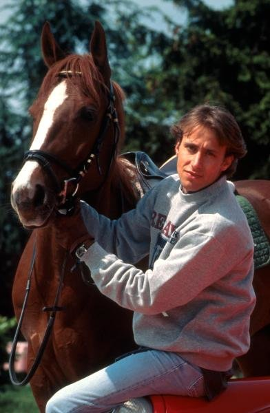 Luca Badoer (ITA) with a horse.   Formula One Drivers at Home Feature. Catalogue Ref.: 15-175 Sutton Motorsport Images Catalogue