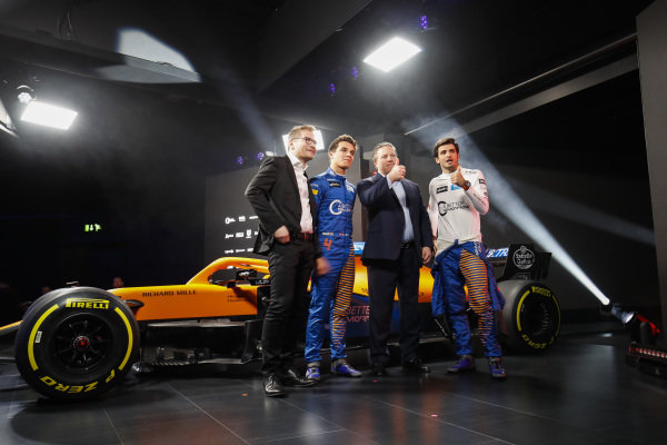 Zak Brown, CEO, McLaren Racing, Andreas Seidl, Team Principal, McLaren, Carlos Sainz Jr, McLaren, and Lando Norris, McLaren watch the launch of the McLaren MCL35