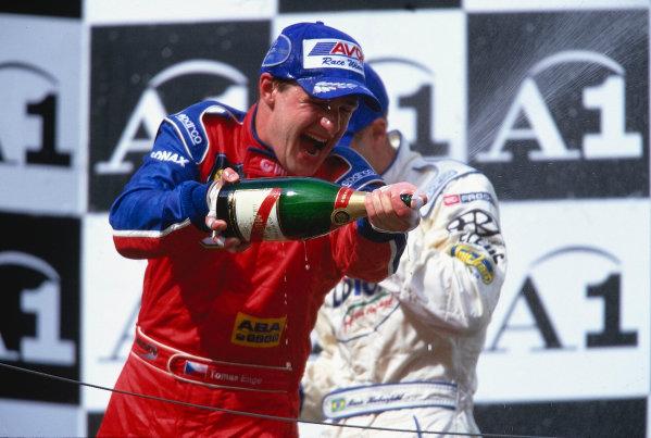 2002 F3000 ChampionshipA1-Ring, Austria. 11th May 2002.Race podium - Tomas Enge (Arden International), sprays champagne.World Copyright: Clive Rose/LAT Photographicref: 35mm Image A03