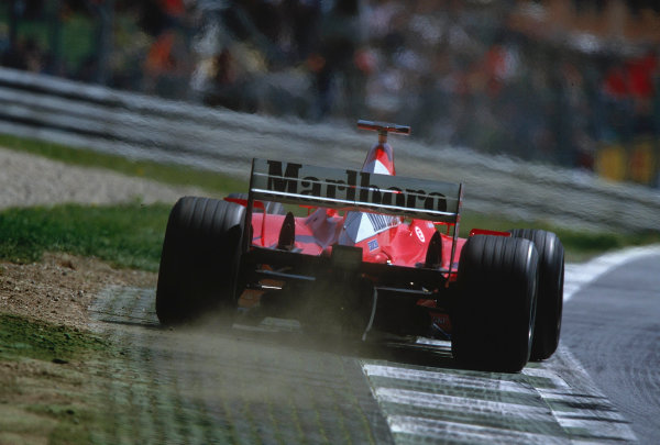 2002 Austrian Grand Prix.A1-Ring, Zeltweg, Austria.10-12 May 2002.Michael Schumacher (Ferrari F2002) 1st position uses all of the track, running over the apex and rumble strip.Ref-02 AUT 13.World Copyright - LAT Photographic