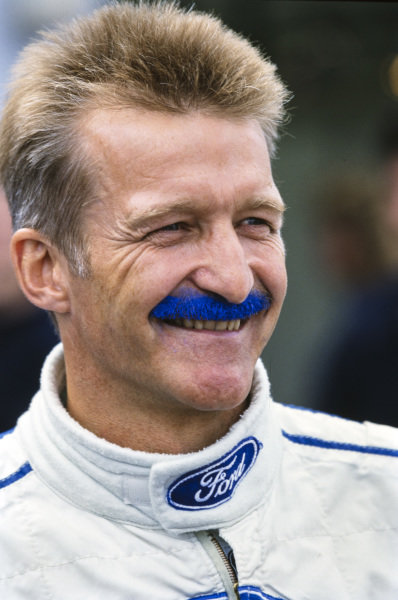 Will Hoy with his moustache dyed the blue of Ford.