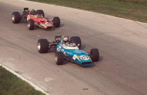1969 Italian Grand Prix.Monza, Italy.5-7 September 1969.Jackie Stewart (Matra MS80 Ford) 1st position, followed by Graham Hill (Lotus 49B Ford).Ref-69 ITA 07.World Copyright - LAT Photographic