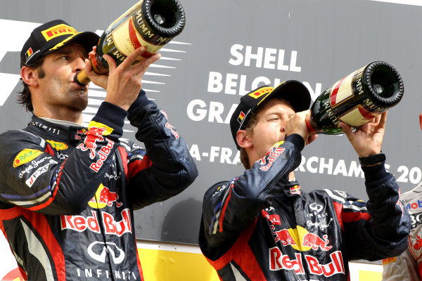 Spa-Francorchamps, Spa, Belgium28th August 2011.Mark Webber, Red Bull Racing RB7 Renault, 2nd position, and Sebastian Vettel, Red Bull Racing RB7 Renault, 1st position, drink Champagne on the podium. Portrait. Podium. World Copyright: Andy Hone/LAT Photographicref: Digital Image CI0C2579
