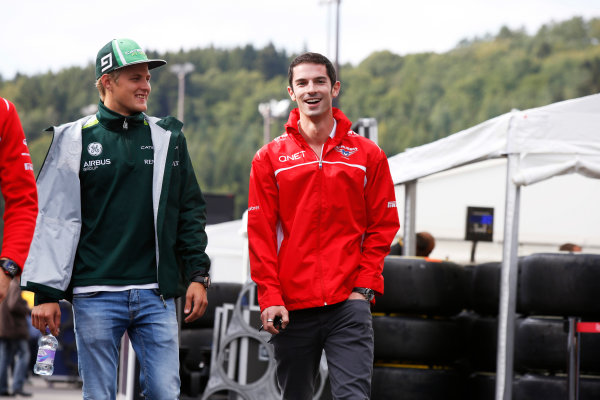 Spa-Francorchamps, Spa, Belgium. Friday 22 August 2014. Marcus Ericsson, Caterham F1, and Alexander Rossi, Marussia. World Copyright: Charles Coates/LAT Photographic. ref: Digital Image _J5R9131
