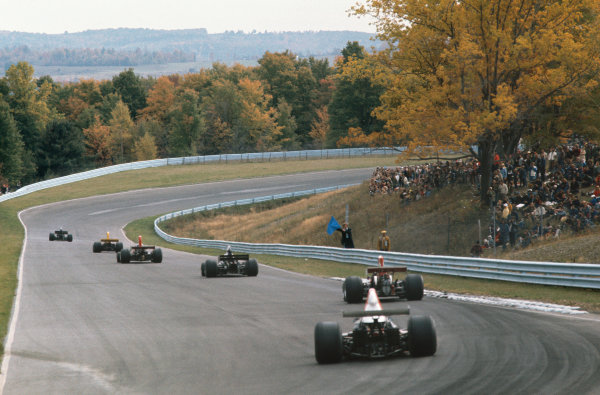 1973 United States Grand Prix.  Watkins Glen, New York, USA. 5-7th October 1973.  A marshal holds out a blue flag as cars head down the hill out of turn 6.  Ref: 73USA06. World copyright: LAT Photographic