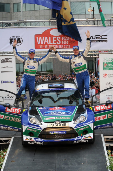 Jari-Matti Latvala (FIN) and Miikka Anttila (FIN), Ford Fiesta RS WRC celebrate victory on the podium. FIA World Rally Championship, Rd10, Wales Rally GB, Day Three, Cardiff, Wales, 16 September 2012.