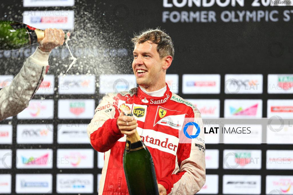 2015 Race Of Champions Olympic Stadium, London, UK Saturday 21 November 2015 Sebastian Vettel (GER) celebrates his Race of Champions win on the podium Copyright Free FOR EDITORIAL USE ONLY. Mandatory Credit: 'IMP'
