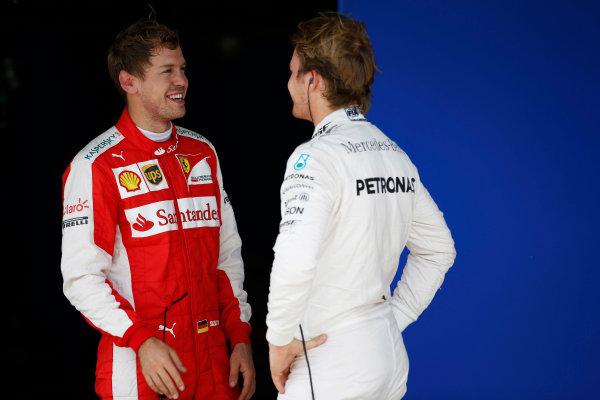 Interlagos, Sao Paulo, Brazil. Saturday 14 November 2015. Pole starter Nico Rosberg, Mercedes AMG, talks with Sebastian Vettel, Ferrari, 3rd on the grid. World Copyright: Glenn Dunbar/LAT Photographic ref: Digital Image _W2Q5185