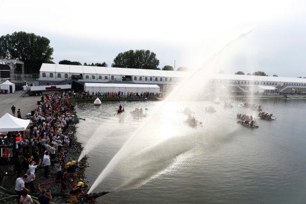 Circuit Gilles Villeneuve, Montreal, Canada. Saturday 10 June 2017. Firefighters launch hoses at the raft race participants. World Copyright: Glenn Dunbar/LAT Images ref: Digital Image _X4I7176