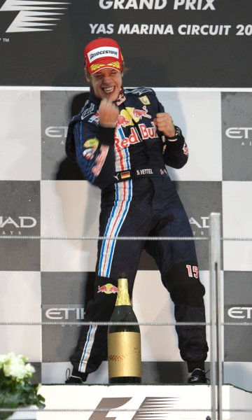 Yas Marina Circuit, Abu Dhabi, United Arab Emirates 1st November 2009. Sebastian Vettel, Red Bull Racing RB5 Renault, 1st position, celebrates victory on the podium. Portrait. Podium.  World Copyright: Steve Etherington/LAT Photographic ref: Digital Image SNE17931