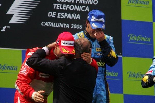 King Juan Carlos of Spain hugs Michael Schumacher (GER) Ferrari on the podium. Formula One World Championship, Rd 6, Spanish Grand Prix, Race, Barcelona, Spain, 14 May 2006.  DIGITAL IMAGE