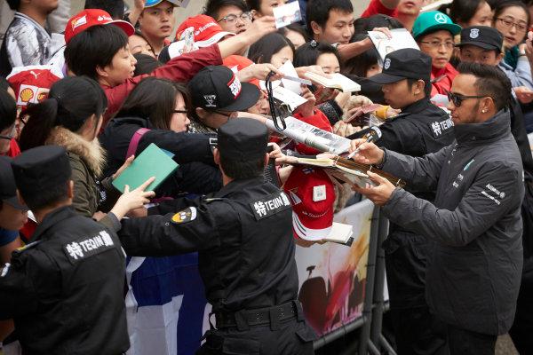 Shanghai International Circuit, Shanghai, China. Thursday 9 April 2015. Lewis Hamilton, Mercedes AMG signs autographs for fans. World Copyright: Steve Etherington/LAT Photographic. ref: Digital Image SNE26873