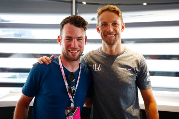 Monte Carlo, Monaco. Saturday 27 May 2017. Jenson Button, McLaren MCL32 Honda, poses for a picture with cyclist Mark Cavendish. World Copyright: Andy Hone/LAT Images ref: Digital Image _ONY0187