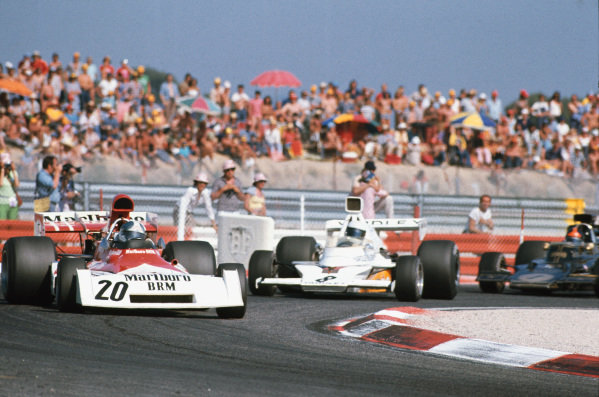 1973 French Grand Prix.  Paul Ricard, Le Castellet, France. 29th June - 1st July 1973.  Jean-Pierre Beltoise, BRM P160E, and Jody Scheckter, McLaren M23 Ford, drift into a croner followed by Emerson Fittipaldi, Lotus 72E Ford.  Ref: 73FRA58. World Copyright: LAT Photographic