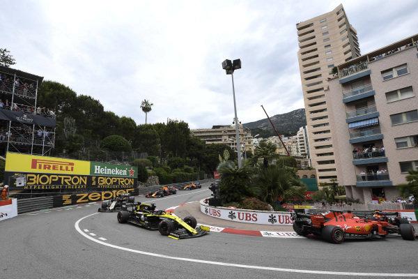 Sebastian Vettel, Ferrari SF90, leads Daniel Ricciardo, Renault R.S.19, and Kevin Magnussen, Haas VF-19