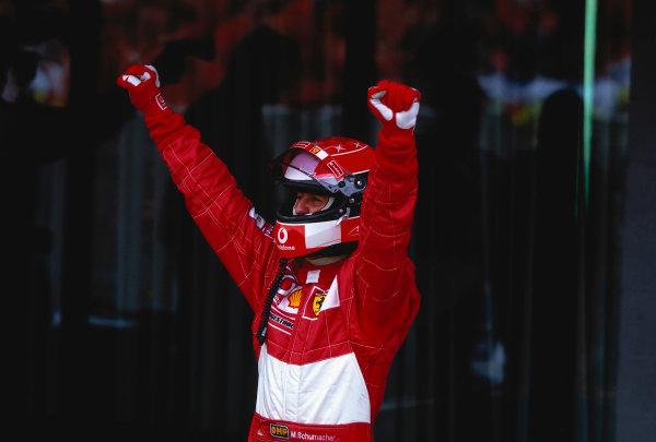 2002 British Grand Prix, Silverstone, England. 7th July 2002. Michael Schumacher celebrates his win. World Copyright - LAT Photographic  Ref: 35mm Original A08