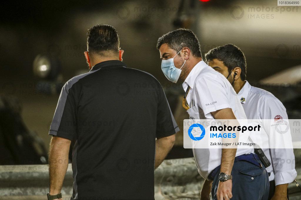 Michael Masi, Race Director, FIA, attends the scene of the huge crash for Romain Grosjean, Haas VF-20