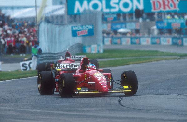 1995 Canadian Grand Prix.Montreal, Quebec, Canada.9-11 June 1995.Jean Alesi (Ferrari 412T2) 1st position for his maiden Grand Prix win.Ref-95 CAN 09.World Copyright - LAT Photographic