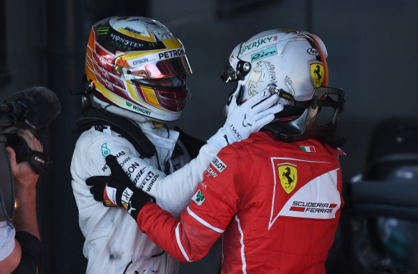 Lewis Hamilton (GBR) Mercedes AMG F1 and Sebastian Vettel (GER) Ferrari celebrate in parc ferme at Formula One World Championship, Rd1, Australian Grand Prix, Race, Albert Park, Melbourne, Australia, Sunday 26 March 2017.