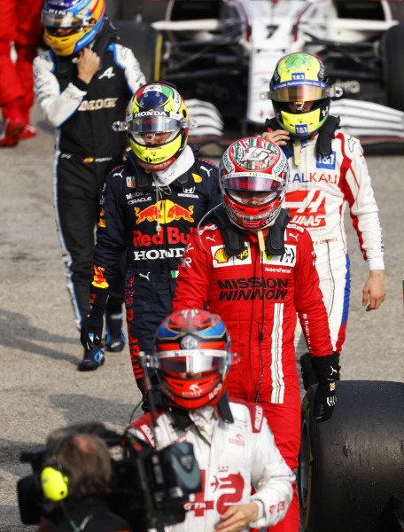 Kimi Raikkonen, Alfa Romeo Racing, Charles Leclerc, Ferrari, Sergio Perez, Red Bull Racing, Mick Schumacher, Haas F1, and Fernando Alonso, Alpine F1