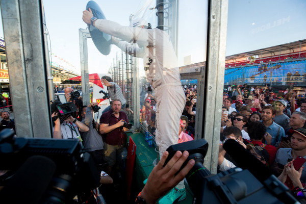 Race winner Nico Rosberg (GER) Mercedes AMG F1 celebrates with fans and the trophy at Formula One World Championship, Rd1, Australian Grand Prix, Race, Albert Park, Melbourne, Australia, Sunday 20 March 2016.