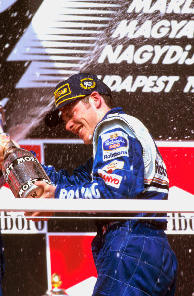 Hungaroring, Budapest, Hungary.9-11 August 1996.Jacques Villeneuve (Williams Renault) 1st position celebrates on the podium.Ref-96 HUN 03.World Copyright - LAT Photographic
