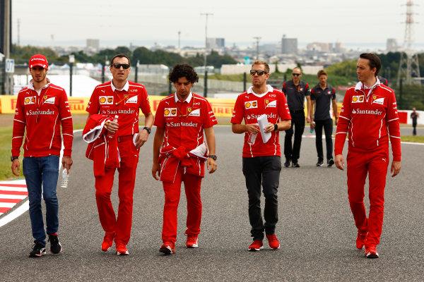 Suzuka Circuit, Japan. Thursday 05 October 2017. Sebastian Vettel, Ferrari, walks the track with his team. World Copyright: Andy Hone/LAT Images  ref: Digital Image _ONZ0668
