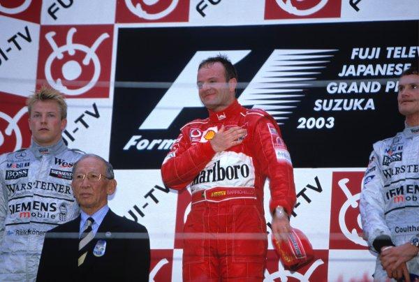 2003 Japanese Grand PrixSuzuka, Japan. 10th - 112th October 2003.Race winner Rubens Barrichello, Ferrari F2003 GA, podium.World Copyright: Lorenzo Bellanca / LAT Photographic ref: 35mm Image 03JAP31
