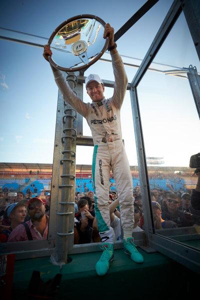 Albert Park, Melbourne, Australia. Sunday 20 March 2016. Nico Rosberg, Mercedes AMG, 1st Position, celebrates with his trophy. World Copyright: Steve Etherington/LAT Photographic ref: Digital Image SNE22070
