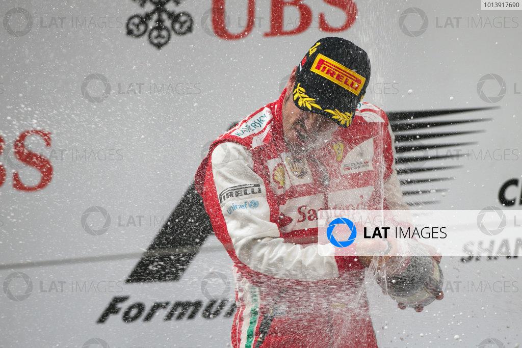 Shanghai International Circuit, Shanghai, China Sunday 14th April 2013 Fernando Alonso, Ferrari, 1st position, celebrates on the podium with Champagne. World Copyright: Andy Hone/LAT Photographic ref: Digital Image HONZ7916